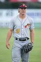 Michael Suchy (13) of the West Virginia Power warms up in the outfield prior to the game against the Kannapolis Intimidators at Intimidators Stadium on July 3, 2015 in Kannapolis, North Carolina.  The Intimidators defeated the Power 3-0 in a game called in the bottom of the 7th inning due to rain.  (Brian Westerholt/Four Seam Images)