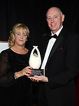 Catriona Culligan from Boomerang Cafe receives the Community Contribution award from Karl Davis representing sponsor Coca Cola International Services at the Business Excellence Awards in Earth Night Club at the Westcourt Hotel. Photo:Colin Bell/pressphotos.ie