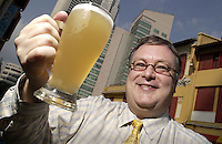 26-SEP-02: HUGH YOUNG: SINGAPORE<br /> Hugh Young of Aberdeen Asset Management raises a glass of beer not far from his office in Singapore's central business district.<br /> Photo by Munshi Ahmed/sinopix<br /> ©sinopix