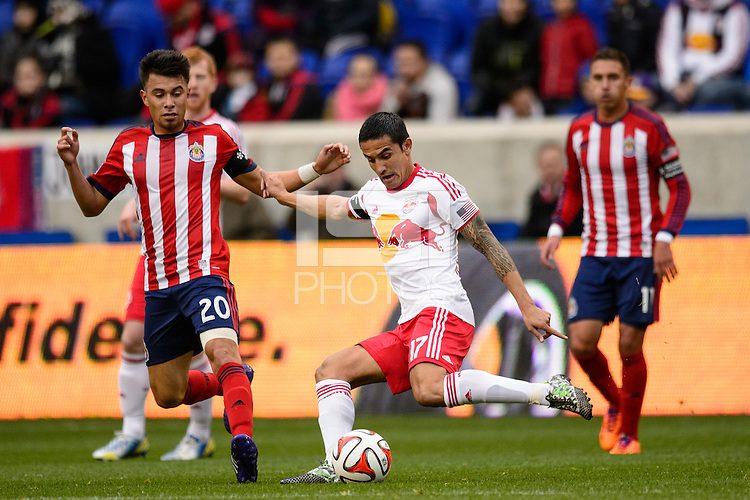 Tim Cahill (17) of the New York Red Bulls is marked by Carlos Alvarez (20) of Chivas USA. The New York Red Bulls and Chivas USA played to a 1-1 tie during a Major League Soccer (MLS) match at Red Bull Arena in Harrison, NJ, on March 30, 2014.