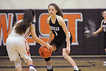 Averie Carlos guards West's Sylvia Xaivong.  Photo for the Star by Michael Dinneen Chugiak at West Thursday, February 15, 2018.  Photo for the Star by Michael Dinneen