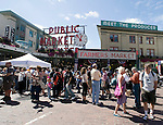 "Visitors gather infront of the landmark ""Public Market"" sign while joining in on the 100th Anniversary celebration of Pike Place Market in Seattle. For a century, the Pike Place Market, has become a city institution and a national attraction, bringing in over a million tourists a year.  .Jim Bryant Photo. ©2010. ALL RIGHTS RESERVED."
