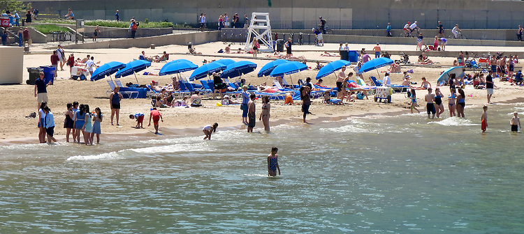 Chicago Scenes - Spring -  Swimming at the Ohio Street Beach on Lake Michigan. (DePaul University/Jamie Moncrief)