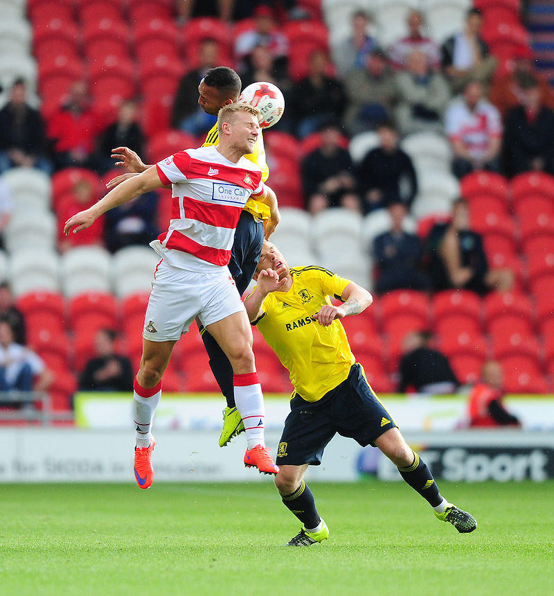 Middlesbrough's Emilio Nsue, and Middlesbrough's Adam Clayton, right, vies for possession with Doncaster Rovers' Curtis Main<br /> <br /> Photographer Chris Vaughan/CameraSport<br /> <br /> Football - Pre-Season Friendly - Doncaster Rovers v Middlesbrough - Saturday 25th July 2015 - Keepmoat Stadium, Doncaster<br /> <br /> &copy; CameraSport - 43 Linden Ave. Countesthorpe. Leicester. England. LE8 5PG - Tel: +44 (0) 116 277 4147 - admin@camerasport.com - www.camerasport.com