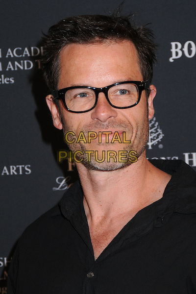 GUY PEARCE.17th Annual BAFTA Los Angeles Awards Season Tea Party held at the Four Seasons Hotel, Beverly Hills, California, USA, 15th January 2011..Portrait headshot shirt beard facial hair stubble glasses black .CAP/ADM/BP.©Byron Purvis/AdMedia/Capital Pictures.