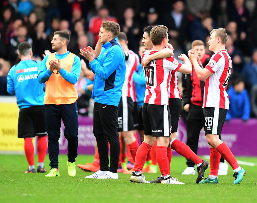 Lincoln City's Adam Marriott celebrates the win with team-mate Sam Habergham at the end of the game<br /> <br /> Photographer Chris Vaughan/CameraSport<br /> <br /> Vanarama National League - Lincoln City v Torquay United - Friday 14th April 2016  - Sincil Bank - Lincoln<br /> <br /> World Copyright &copy; 2017 CameraSport. All rights reserved. 43 Linden Ave. Countesthorpe. Leicester. England. LE8 5PG - Tel: +44 (0) 116 277 4147 - admin@camerasport.com - www.camerasport.com