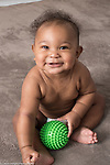 5 month old baby boy at home sitting full length smiling happy