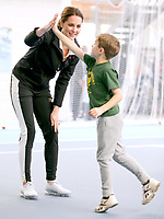 31 October 2017 - Princess Kate, Duchess of Cambridge high-fives a boy as she takes part in a Tennis for Kids session during a visit at the Lawn Tennis Association (LTA) at the National Tennis Centre in southwest London. Duchess of Cambridge visited the LTA, the national governing body of tennis, where she was briefed on the organisations latest activities and objectives, and had the opportunity to watch a number of tennis demonstrations at the National Tennis Centre's on-court facilities. Photo Credit: ALPR/AdMedia