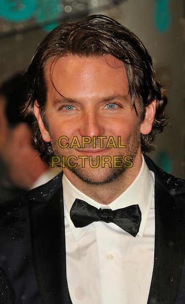 Bradley Cooper.EE British Academy Film Awards at The Royal Opera House, London, England 10th February 2013.BAFTA BAFTAS arrivals headshot portrait black white tuxedo bow tie shirt stubble beard facial hair .CAP/WIZ.© Wizard/Capital Pictures