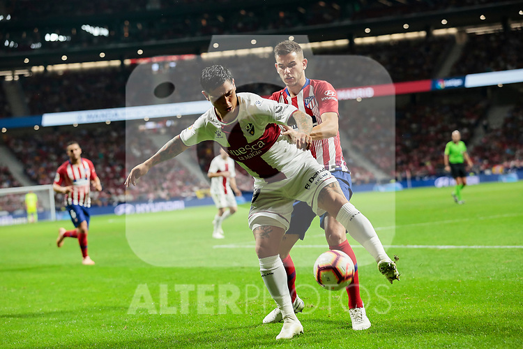 Atletico de Madrid's Lucas Hernandez and SD Huesca's Luis Ezequiel 'Chimy' Avila during La Liga match between Atletico de Madrid and SD Huesca at Wanda Metropolitano Stadium in Madrid, Spain. September 25, 2018. (ALTERPHOTOS/A. Perez Meca)