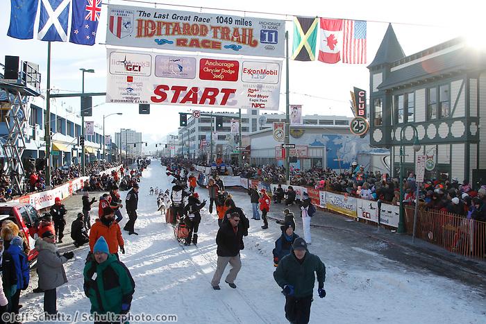 Allen Moore leaves the starting line on 4th avenue in downtown Anchorage, Alaska during the ceremonial start of the 2011 Iditarod