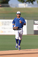 Cristhian Vasquez (44) of the AZL Royals runs in from the field during a game against the AZL Mariners at Surprise Stadium on July 4, 2015 in Surprise, Arizona. Mariners defeated the Royals, 7-4. (Larry Goren/Four Seam Images)