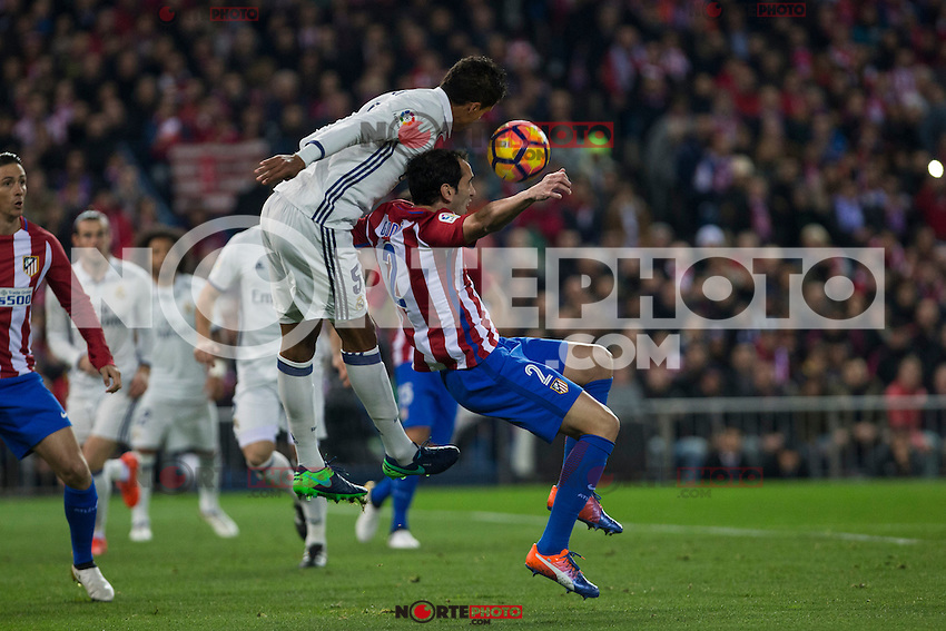 Real Madrid's Raphael Varane Atletico de Madrid's Diego Godin during the match of La Liga between Atletico de Madrid and Real Madrid at Vicente Calderon Stadium  in Madrid , Spain. November 19, 2016. (ALTERPHOTOS/Rodrigo Jimenez) /NORTEPHOTO.COM