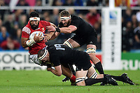 Vili Ma'afu of Tonga is double-tackled by Brodie Retallick and Kieran Read of New Zealand. Rugby World Cup Pool C match between New Zealand and Tonga on October 9, 2015 at St James' Park in Newcastle, England. Photo by: Patrick Khachfe / Onside Images