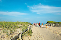 Vacationers walk to the beach along sandy path, Nauset Beach, Cape Cod, MA, USA
