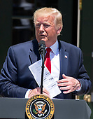 """United States President Donald J. Trump puts his notes in his jacket as he makes remarks while hosting the Third Annual """"Made in America"""" Product Showcase on the South Lawn of the White House in Washington, DC on Monday, July 15, 2019. The President also took questions from the media.<br /> Credit: Ron Sachs / CNP"""