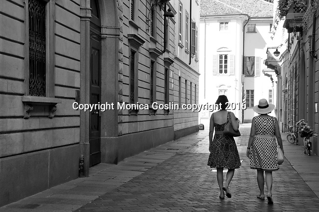 Two women walking down a street in downtown Como, Italy a town on Lake Como