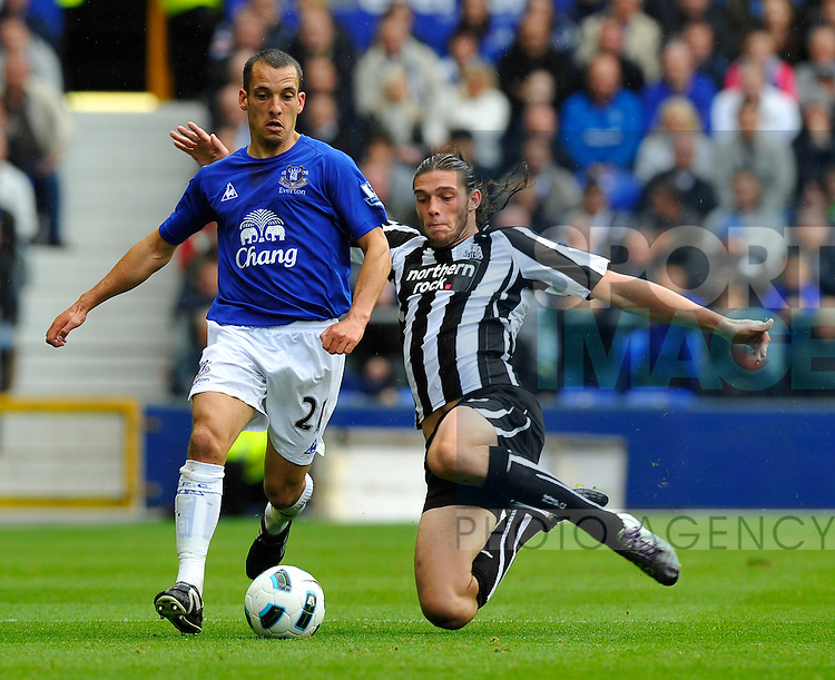 Andrew Carroll of Newcastle United tackles Leon Osman of Everton
