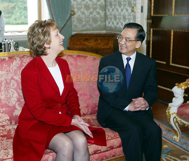 Aras an Uachtarain, Dublin Ireland. Premier of the State Council of the People's Republic of China H.E. Mr. Wen Jiabao (R) speaking over tea with Irish President Mary McAleese on day two of his State Visit to Ireland, Dublin 12th May 2004.Photo AFP/NEWSFILE/FRAN CAFFREY..(Photo credit should read FRAN CAFFREY/NEWSFILE/AFP)...This Picture has been sent you under the condtions enclosed by:.Newsfile Ltd..the Studio,.Millmount Abbey,.Drogheda,.Co Meath..Ireland..Tel: +353(0)41-9871240.Fax: +353(0)41-9871260.GSM: +353(0)86-2500958.email: pictures@newsfile.ie.www.newsfile.ie.FTP: 193.120.102.198..This picture is from Fran Caffrey@newsfile.ie