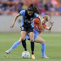 Houston Texas - Becca Moros (4) of the Houston Dash battles for the ball with Christen Press (23) of the Chicago Red Stars in the first half on Saturday, April 16, 2016 at BBVA Compass Stadium in Houston Texas.  The Houston Dash defeated the Chicago Red Stars 3-1.