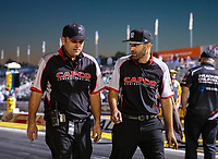 Nov 9, 2018; Pomona, CA, USA; Crew members Bobby Lagana (left) and brother Dom Lagana for NHRA top fuel driver Steve Torrence during qualifying for the Auto Club Finals at Auto Club Raceway. Mandatory Credit: Mark J. Rebilas-USA TODAY Sports