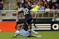 Omar Bravo (on ground) Sporting KC makes a tackle on Shea Salinas Vancouver Whitecaps... Sporting KC defeated Vancouver Whitecaps 2-1 at LIVESTRONG Sporting Park, Kansas City, Kanas.