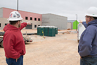 Kyle Loy, field engineer, (from left) and Scott Brogan, superintendent, tour the construction of a new middle school, Thursday, January 9, 2019 on the corner of North Vaughn and Holloway roads in Centerton<br /> <br /> The Bentonville School District is preparing to open its fourth junior high school this fall, Grimsley Junior High School. Check out nwaonline.com/200111Daily/ for today's photo gallery.<br /> (NWA Democrat-Gazette/Charlie Kaijo)