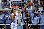 05 January 2015: North Carolina's Brice Johnson (11) blocks a shot by Notre Dame's Jerian Grant (right). The University of North Carolina Tar Heels played the University of Notre Dame Fighting Irish in an NCAA Division I Men's basketball game at the Dean E. Smith Center in Chapel Hill, North Carolina. Notre Dame won the game 71-70.