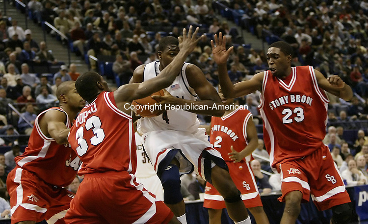 HARTFORD, CT 28 DECEMBER 2005 122805BZ03-     UConn #4, Jeff Adrien works his way through the defense of Stony Brook University <br /> during their game at the Hartford Civic Center Wednesday night. <br /> Jamison C. Bazinet Republican-American