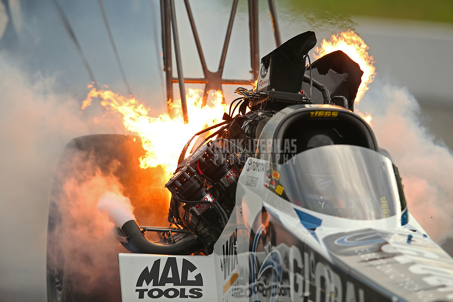 Jun 17, 2017; Bristol, TN, USA; NHRA top fuel driver Shawn Langdon explodes an engine on fire during qualifying for the Thunder Valley Nationals at Bristol Dragway. Mandatory Credit: Mark J. Rebilas-USA TODAY Sports