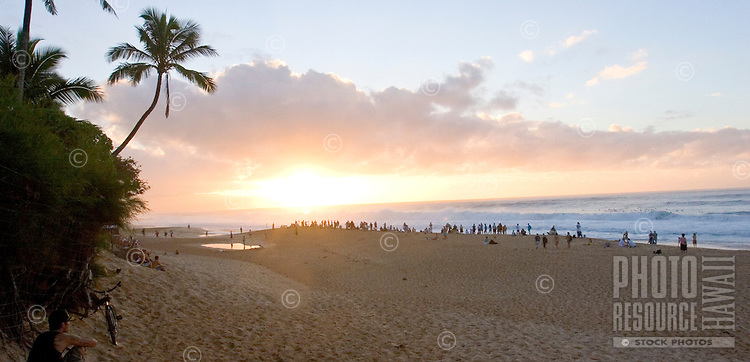 Sunset at Ehukai beach park overlooking famous surf break Banzai Pipeline.
