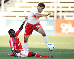 28 March 2007: New York's Claudio Reyna (10) dribbles through the tackle of a Toronto player. Toronto FC defeated the New York Red Bulls 2-1 at Blackbaud Stadium in Cary, North Carolina in the 2007 Carolina Challenge Cup.