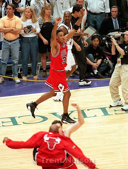 Scottie Pippen celebrates NBA Championship while Bryon Russell walks off court at Jazz vs. Bulls, game 6 of the NBA Finals. Bulls won<br />