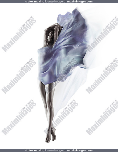 Artistic surreal image of a beautiful naked woman with flowing blue translucent cloth wrapping her nude body and fluttering like wings isolated on white background