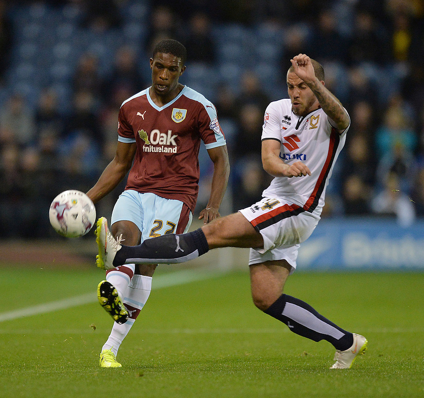 Burnley's Tendayi Darikwa battles with MK Dons' Samir Carruthers<br /> <br /> Photographer Dave Howarth/CameraSport<br /> <br /> Football - The Football League Sky Bet Championship - Burnley v Milton Keynes Dons - Tuesday 15th September 2015 - Turf Moor - Burnley<br /> <br /> &copy; CameraSport - 43 Linden Ave. Countesthorpe. Leicester. England. LE8 5PG - Tel: +44 (0) 116 277 4147 - admin@camerasport.com - www.camerasport.com