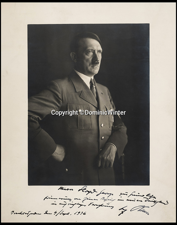 """BNPS.co.uk (01202 558833)<br /> Pic: DominicWinter/BNPS<br /> <br /> A personal portrait Hitler gave to David Lloyd George during his controversial visit to the Berchtesgaden has emerged for sale.<br /> <br /> Lloyd George, the Prime Minister during the First World War against Germany, visited Hitler's home in the Bavarian Alps in 1936.<br /> <br /> He met Hitler alone on September 4 at the Berghof and then returned for a tea party the following night where he was presented with this portrait by the Fuhrer.<br /> <br /> The 11in by 9in portrait was accompanied by a personal message from Hitler, which translated into English read: """"Mister Lloyd George, in kind remembrance of his contribution to my Germany with circumspect presentiment."""""""