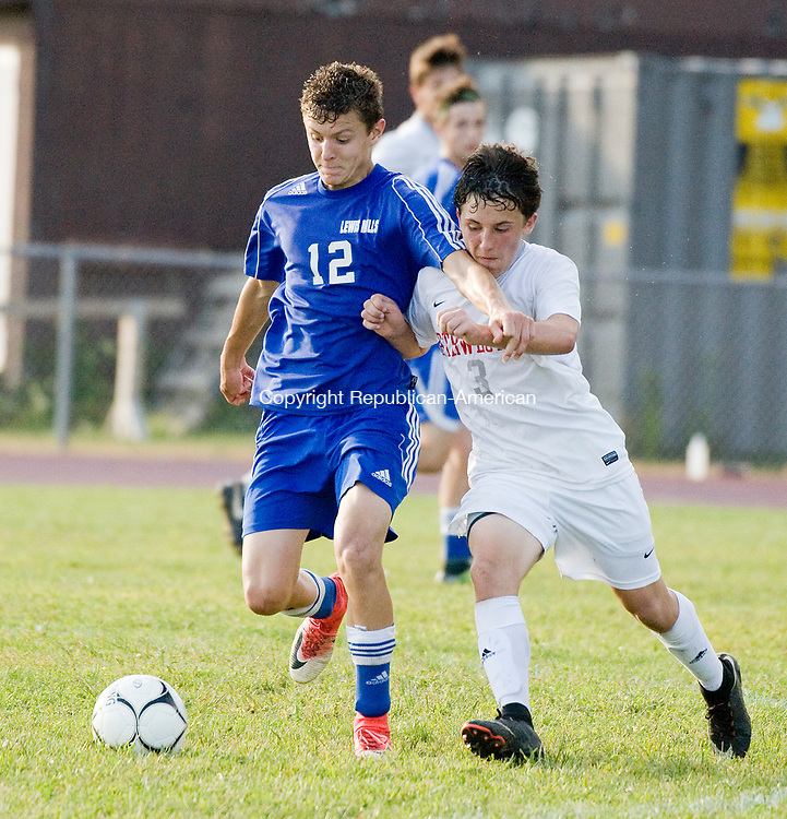 WINSTED, CT-091517JS21-- Lewis Mills' Matt Gilbert (12) and Northwestern's Trey Neumann (3) battle for the ball during their game Friday at Northwestern Regional High School in Winsted.<br /> Jim Shannon Republican-American
