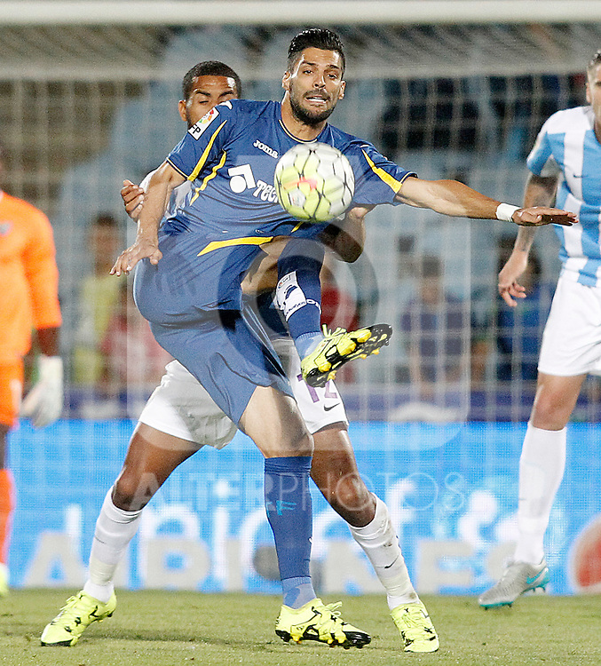 Getafe's Angel Lafita (f) and Malaga's Fernando Damian Tissone during La Liga match.September 18,2015. (ALTERPHOTOS/Acero)