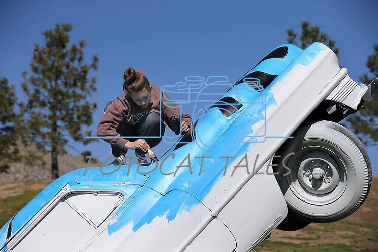 Doral Red Rock Academy student Rachel Grauberger, 16, paints a Cadillac at the driving range at the Silver Oak Golf Course, in Carson City, Nev., on Sunday, April 8, 2018. The Las Vegas art students' work was a Carson City history theme. <br /> Photo by Cathleen Allison/Nevada Momentum