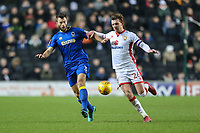 Jonathan Meades of AFC Wimbledon and Alex Gilbey of MK Dons during the Sky Bet League 1 match between MK Dons and AFC Wimbledon at stadium:mk, Milton Keynes, England on 13 January 2018. Photo by David Horn.