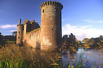 Scottish medieval castle Caerlaverock Castle catching the summer evening sunshine near Dumfries Scotland Britain