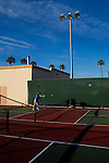 A tennis club practices at the Marinette Recreation Center in Sun City, Arizona, an age-restricted city of more than 40,000 retirees, December 2011.