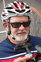 Morehead City, NC -- Buttons allow Paul to shift the bike's gears with his chin. Quadriplegic hand cyclist Paul Kelly, 62, trains for the Boston Marathon Tuesday, March 27, 2018. (Justin Cook for The Wall Street Journal)<br /> <br /> SUMMARY:<br /> <br /> Paul Kelly, hand cyclist, Beaufort, NC Training for the Boston Marathon so we would want to shoot in March to run the week before the marathon or marathon Monday, Apriln16. Life as a quadriplegic doesn't keep 62-year-old Paul Kelly on the sidelines. After breaking his neck in a swimming accident in 1978, Kelly was determined to find fitness activities to maintain an active lifestyle. He discovered handcycles while watching his niece compete in the 2006 Marine Corps Marathon and was inspired to start his own marathon career to stay fit. Paul has competed in over 100 half and full marathons. On April 16, he will celebrate his 40th year of living as a quadriplegic by taking on one of the most coveted races for a marathoner -- the Boston Marathon. Kelly is among the 60 handcyclists competing in the 2018 Boston Marathon with a qualifying time of 1:26:37. Most of Paul's distance training takes place at Bogue Banks, which includes Atlantic Beach, Salter Path, and Emerald Isle, N.C. It's Nicholas Sparks worthy scenery with its marshes, waterways, inlets and small islands. Paul is particularly fond of the approach from Atlantic Beach to Bogue Banks -- it's via the high-rise bridge. In cold weather, Paul has to be mindful of the environment and dress in a manner that insulates his legs while also allowing his upper body to ventilate. Paul chooses to train at times of day when the temperatures are more reasonable. He uses hand warmers in his gloves, on the inside the grips on his handcycle and in the legs of his trousers.