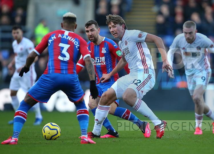 Sander Berge of Sheffield Utd tackles Patrick van Aanholt of Crystal Palace during the Premier League match at Selhurst Park, London. Picture date: 1st February 2020. Picture credit should read: Paul Terry/Sportimage