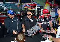 Sept. 29, 2012; Madison, IL, USA: NHRA top fuel dragster driver  Brandon Bernstein, with funny car drivers Tony Pedregon and Cruz Pedregon during qualifying for the Midwest Nationals at Gateway Motorsports Park. Mandatory Credit: Mark J. Rebilas-