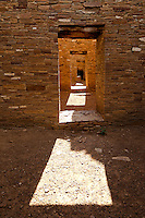 Doorways and light within Pueblo Bonito at Chaco Culture National Historical Park in New Mexico. Pueblo Bonito was constructed in stages between AD 850 to AD 1150 by the ancestral Puebloan peoples and is considered the center of the Chacoan world.