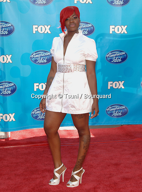 Fantasia  - <br /> American Idol  Finale 2008 at the Nokia Theatre In Los Angeles.<br /> <br /> Celebrity,<br /> Entertainment,<br /> full length<br /> eye contact<br /> red wig