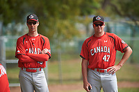 Canada Junior National Team pitching coaches Jeff Francis (46) and Scott Mathieson (47) during an exhibition game against the Toronto Blue Jays on March 8, 2020 at Baseball City in St. Petersburg, Florida.  (Mike Janes/Four Seam Images)