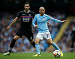 Luka Milivojevic of Crystal Palace and David Silva of Manchester City during the premier league match at the Etihad Stadium, Manchester. Picture date 22nd September 2017. Picture credit should read: Simon Bellis/Sportimage