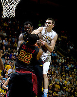 David Kravish of California tries to steal the ball away from Dewayne Dedmon of USC during the game at Haas Pavilion in Berkeley, California on February 17th, 2013.  California defeated USC, 76-68.